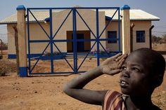 A South Sudanese child stands in front of a newly constructed police post in Northern Bahr el Ghazal, supported by UNDP. www.undp.org  UNDP South Sudan/Brian Sokol