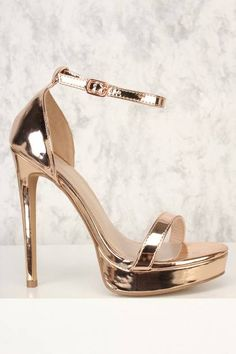 These cute heels are the perfect go to for a simple look! Featuring; patent metallic, faux leather, open toe, platform, side ankle closure. Approximately 5 inch heel, 1 inch platform.