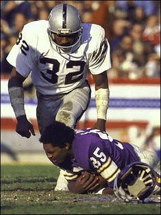 #32 Jack Tatum of the Oakland Raiders knocking the Helmet off of #85 Sammy White of the Minnesota Vikings in Super Bowl XI