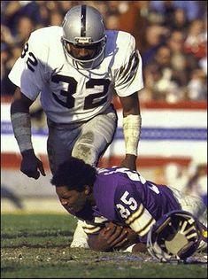 #32 Jack Tatum of the Oakland Raiders knocking the Helmet off of #85 Sammy White of the Minnesota Vikings in Super Bowl XI