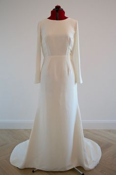Luxurious ivory crepe wedding gown with long sleeves,fit and flare skirt and boat neck.#modern bride #minimalbride #chicbride #elegantbridal