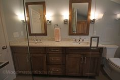 It's all about the details in this charming transitional style master #bathroom #design . The large vanity with two MR Direct sinks is accented by matching framed mirrors. A large shower is the centerpiece of this #BathroomRemodel . It includes a tile feature in the center of the wall with Agate Bari Pearl 1x1 hexagon #mosaic #tile, a Euro style shower door, and both rainfall and handheld #showerheads . Underfloor heating, a linen cabinet, and Panasonic bath fan complete the design.