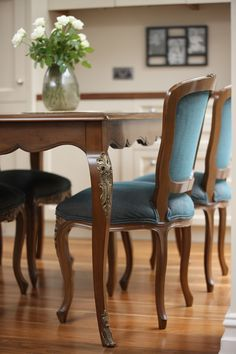 The French Louis XV dining table Beatrice paired with our Maine dining chairs. Both crafted from French cherry wood and finished in our Honeycomb finish.