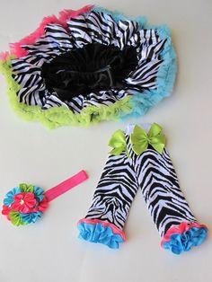 Boutique Zebra Petti Skirt, Ruffle Leg Warmers, Satin Flower Cluster Newborn Photos or Birthday Set. $30.99, via Etsy.