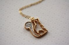 Squirrel silhouette necklace via etsy