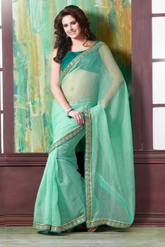This green colour designer party wear saree looks awesome and the main key feature of the saree is the lace on it and the blouse makes the saree more beautiful when you wear it.