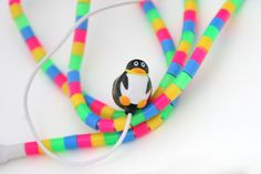 "Perler bead covered ""penguin"" ear buds ...I can see this being a fun project this summer with the kids and their friends."