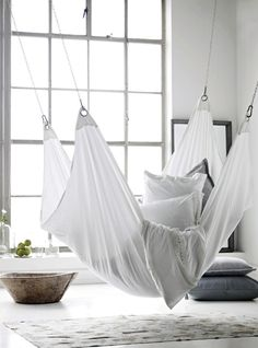 White hammock, pillows, wide windows, rug  cc: @Bree Derbecker