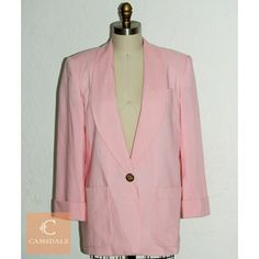 """80s - 90s Style Pretty In Pink Blazer Pretty in pink blazer jacket with 1 gold coat of arm design front closure button. Shoulder pads + 2 large front pockets. Shell: 50% polyester, 50% rayon, lining: 100% acetate. In great vintage condition, minor stain at right sleeve hemline.  Shoulders: 16"""" Bust: 20.5"""" Waist: 21"""" Length: 29.5"""" Jackets & Coats Blazers"""