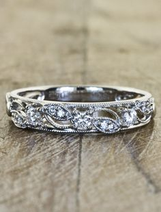 different yet simple wedding band style: Emeli. This website has beautiful nature inspired engagement rings.