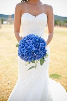 Vivid blue hydrangea wedding bouquet | Floral designer unknown.