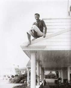 Reminiscent of a childhood escapade, a daring Jack on the rooftop of the Hyannis Port home, circa 1940-1941 - Rose Kennedy's family album