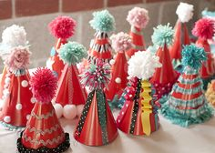 Cute party hat idea.  You could even let older kids decorate their own.