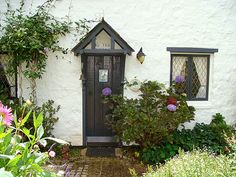 Fig Tree Cottage: English Country Style in Australia - Hooked on Houses - Adorable cottage door on an Australian vacation rental. doors of the world. Cottage Front Doors, Cottage Door, Cottage Exterior, Rose Cottage, Cottage Homes, Garden Cottage, Cottage Living, English Country Cottages, English Cottage Style