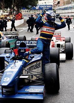 Olivier Panis with arms aloft climbs from his Equipe Ligier Gauloises Blondes Ligier JS43 MugenHonda 30 V10 to celebrate victory at the Grand Prix of...