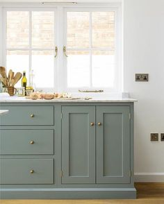☀️☕️Sunday morning is so sweet in this sun filled kitchen by @devolkitchens. We are smitten with that blue grey cabinet + brass hardware. #currentinspiration #kitchendesign