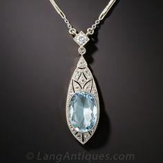 Edwardian Aquamarine and Diamond Pendant. Delicately hand fabricated in platinum over 18K gold during the first decade of the last century, this exquisite Edwardian adornment glistens and glows with a beautiful 2.00 carat, Caribbean blue, faceted oval aquamarine embellished with small glittering rose-cut diamonds