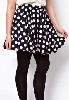 Plus Size Polka Dot Skater Skirt  Bold graphic prints AND skater skirts are huge right now.  And that a cute way to incorporate them into your wardrobe!  This top will go great with a plain white blouse and some tights like in the picture, or even a lighter shade of blue on top to create a monochromatic look.