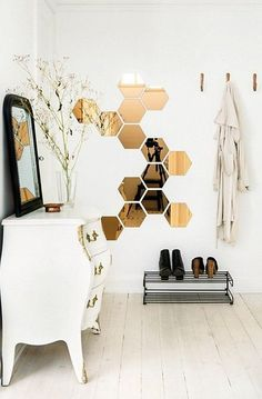 Mirrored metallic wall decals are a simple way to add some wow to your white interiors.