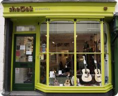 Love this bright and cheery music shop Guitar Store, Music Store, Guitar Display, Acoustic Guitar, Exterior Design, Shops, Factories, Urban Design, Guitars