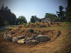 Front Bank Retaining Boulders and Landscape improvements in progress...