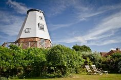 The four-storey Old Smock Mill in Kent is available for £880 per week for two people. Insi...