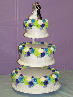 Royal Icing Flowers In Blue, Purple, And Lime