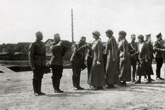 Staff officers greeting Olga, Tatiana, Maria and Anastasia at GHQ. Mogilev. 1916