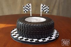 Vanilla cake with vanilla frosting, covered in fondant. We lost count of how many treads were individually placed! Racing Cake, Race Car Cakes, Pretty Cakes, Beautiful Cakes, Amazing Cakes, Fondant Cakes, Cupcake Cakes, Fondant Bow, Cupcakes