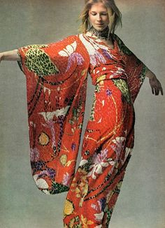 """""""Vogue, July 1970 of Candice Bergen in a cut panne velvet kimono dress designed by Bill Blass.""""A dress for utterly luxurious evenings at home, wrapped with a high obi sash, long sleeves slipping, dipping from the arm like folding wings,"""" was Vogue's description."""""""