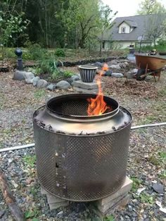 An old washing machine drum makes a great rust-proof garden fire pit. Washing Machine Drum, Square Fire Pit, Garden Fire Pit, Recycled Garden, Rust, Garden Design, Recycling, Outdoor Decor, Design Ideas