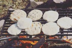 """This mornings breakfast cookout of arepas over the fire, a delicious traditional Venezuelan cornflour patty filled to your hearts desirea favourite…"""