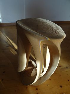 Stool (solid pine logs) chainsaw art, abstract wood sculpture.