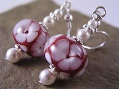 Beautiful earrings by Jennifer Lynn Studio created with handtorched lampwork beads made by Eric Larson of Enchanted Dreams Jewelry.