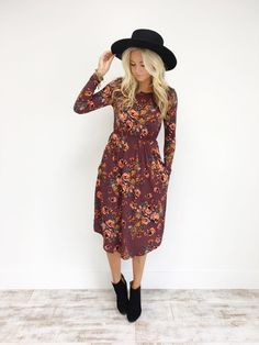 Wine Midi w/ Pink Floral Long Sleeved Pockets Elastic Waistband Fits True to Size Also Available in Navy + Black Length Chart Models is Wearing a Small in Black