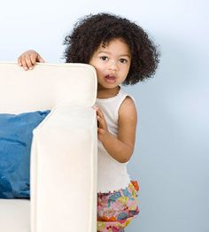 """The Secret Language of Toddlers: What Their Behaviors Mean - She hides behind the furniture when she poops in her diaper. Translation: """"I want privacy."""""""