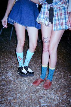Cat tattoo. LOL at the dark blue socks. XD