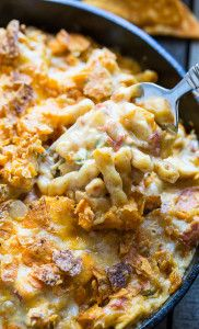 King Ranch Casserole in mac and cheese form. Creamy and spicy with diced chicken and a crushed dorito topping.