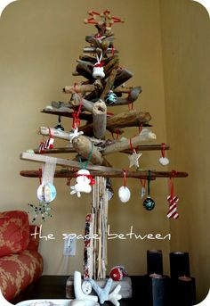 homemade driftwood Christmas tree decorated with DIY ornaments - tutorials included