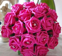 Hot pink small bouquet roses. Fuschia wedding posy. The Brides Bouquet - Bridal Ranges £15
