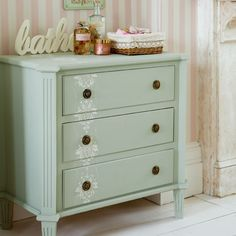 lovely subtle damask stencilling down one side of a chest painted in a soft green.