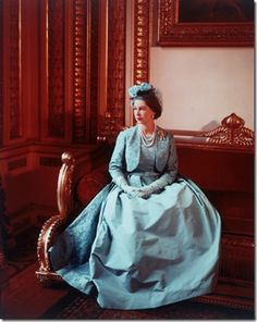 """Photograph by Cecil Beaton of HRH Queen Elizabeth II: 6 May 1960, the image was taken in the Throne Room of Buckingham Palace on the occasion of Marriage of Princess Margaret at Westminster Abbey.  The Queen was wearing a Norman Hartnell gown and the """"Lover's Knot"""" brooch."""