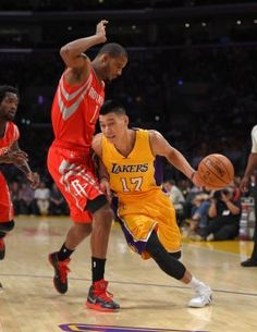 Los Angeles Lakers guard Jeremy Lin, right, drives toward the basket as Houston Rockets guard Trevor Ariza defends during the first half of an NBA basketball game, Tuesday, Oct. 28, 2014, in Los Angeles. (AP Photo/Mark J. Terrill)
