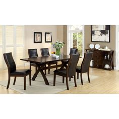 This Ayala dining set is perfect for entertaining friends and family with style. The set offers a 78-inch dining table with leaf and six leatherette-upholstered Parson dining chairs all on a warm dark oak finished bases.