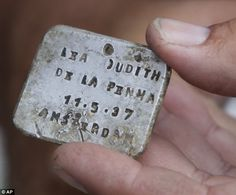 Archaeologist excavated Polish Nazi Death Camp of Sobibor. 'Symbol of Sobibor': This engraved identity tag retrieved from the site belonged to a six-year-old Jewish girl murdered at the camp