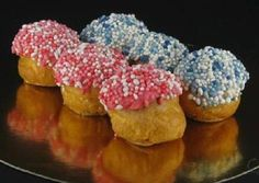 "kraam soesjes... in holland we always serve these little sprinkles when a baby is born....normally we put it on round crispy bread ""beschuit met muisjes"" ..these are puffs"