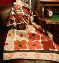 Winter Flowers by Ramona Sorensen in Best Fat Quarter Quilts 2014.