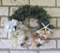 Christmas Coastal Wreath with Shells by HomeSweetCoast on Etsy https://www.etsy.com/listing/113923180/christmas-coastal-wreath-with-shells