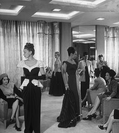 June 1945    Models displaying evening gowns to customers at the Dallas Nieman Marcus department store.