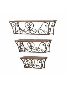 Set of 3 wall shelves with scrollwork metal bases and wood tops. Product: Small, medium and large wall shelfConstruction Material: Metal and woodColor: Rust and naturalFeatures: Sublime curvesDimensions: Small: H x W x D Medium: H x W x D Large: H x W x D Wood Wall Shelf, Wall Mounted Shelves, Display Shelves, Shelving, Corner Shelves, Decoration Entree, Reno, Accent Furniture, Iron Furniture